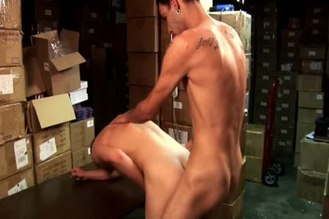 Two gay men banging On A Desk In A Store Room