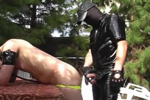 A man Dressed In Latex Who Wants To nail