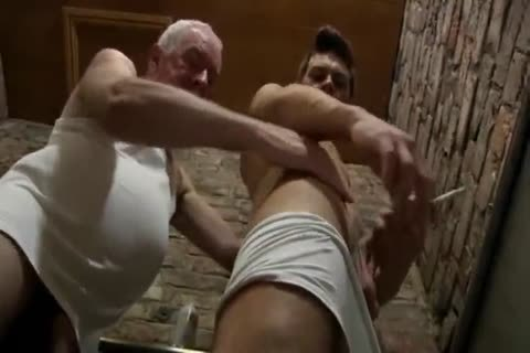 nice Looking grand-dad & young chap engulf Each Other In A Public